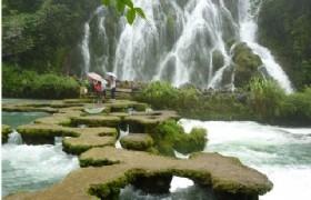 walk to waterfall in xiaoqikong